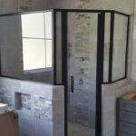 Custom framed glass shower enclosure